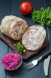 Aspic with meat and horseradish on a wooden table Royalty Free Stock Photos