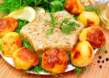Aspic from meat with roasted potatoes stock photo