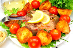 Aspic from meat with roasted potatoes Royalty Free Stock Images