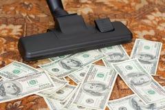 Aspirador y dinero Foto de archivo libre de regalías