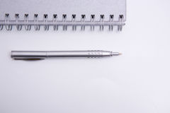 Aspiral notebook and pen Stock Photography