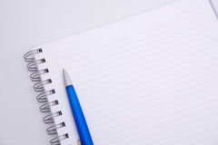 Aspiral notebook and pen Royalty Free Stock Images