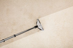Aspirapolvere con tappeto Immagine Stock Libera da Diritti