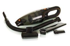 Aspirapolvere senza cordone moderno con gli ugelli intercambiabili, isolati su bianco Fotografia Stock