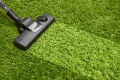 Aspirapolvere sul pavimento Fotografie Stock