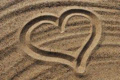 Aspiration de foyer sur le sable Photographie stock