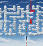 Aspiration Leadership Solutions. With a businessman climbing a red ladder that has found an answer to a cloud shaped labyrinth or maze as a symbol of career Stock Photo