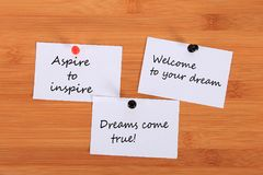 Aspire to inspire. Welcome to your dream. Dreams come true! Note pin on the bulletin board. Aspire to inspire. Welcome to your dream. Dreams come true! Note pin royalty free stock image