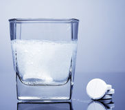 Aspirin. Fizzy tablet in a glass of water Royalty Free Stock Photo