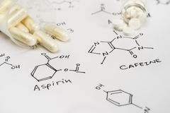 Aspirin in capsules and caffein in tablets Stock Photo