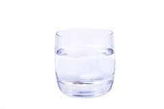 Aspirin dissolving in the glass of water. Isolated over white background Stock Photos
