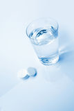 Aspirin Glass. Headache tablets and glass of water stock photo