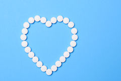 Aspirin in Heart Shape Royalty Free Stock Photography