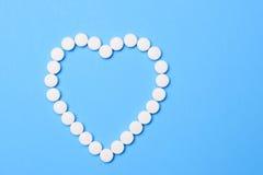 Aspirin nella forma del cuore Fotografia Stock Libera da Diritti
