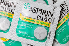 Aspirin plus C headache pills lies on brown background. Stock Image
