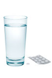 Aspirin and water. Aspirin and fresh water isolated on a white background Stock Photos