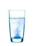 Aspirina en un vidrio Foto de archivo libre de regalías