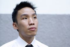 Aspiring asian male executive look up Royalty Free Stock Images