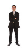 Aspiring businessman. An aspiring businessman standing in front of a plain white background stock photography
