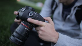 Aspiring Photographer Learns To Shoot At A Professional SLR Camera stock footage