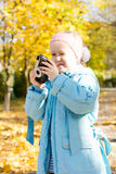 Aspiring young girl photographer Stock Image