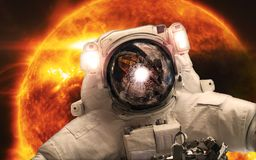 Asrtonaut in the space on the orange giant star background. Elements of this image furnished by NASA stock photo