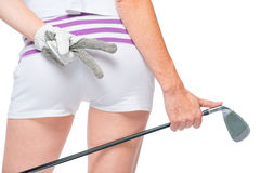 Ass golfer close-up with golf club in hand on white Royalty Free Stock Photo
