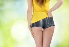 Ass woman wearing a short denim shorts Stock Image