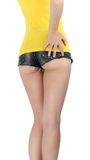 Ass woman wearing a short denim shorts. Ass woman wearing a short jeans shorts with yellow tank top Stock Image
