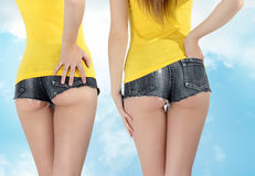 Ass woman wearing a short jeans Royalty Free Stock Photos