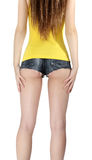 Ass woman wearing a short jeans shorts with yellow tank top. On white background Stock Image