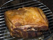 Assado da carne de porco no fumador Imagens de Stock