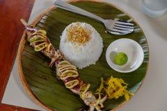 Assado do calamar com arroz Fotos de Stock