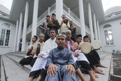 Assalam cottage students. Sukoharjo, Central Java Indonesia posing and singing using a tambourine in the cottage Assalam royalty free stock photos
