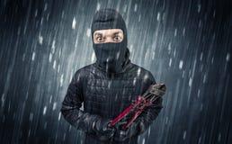 Assaltante travado pela câmera da casa na ação Fotografia de Stock