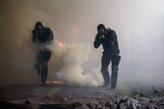 Assalto nel fumo Fotografia Stock Libera da Diritti