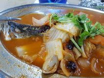 Assam fish. Large spicy vege stock photo