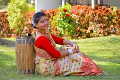 Assamese girl In traditional attire posing with A Dhol, Pune, Maharashtra. royalty free stock images