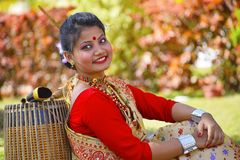 Assamese girl In traditional attire posing with A Dhol, Pune, Maharashtra. stock image