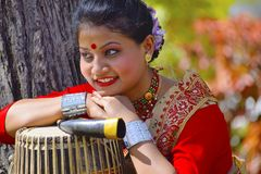 Assamese girl In traditional attire posing with A Dhol, Pune, Maharashtra. royalty free stock photography