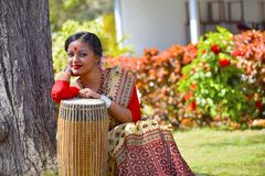 Assamese girl In traditional attire posing with A Dhol , Pune, Maharashtra. royalty free stock photos
