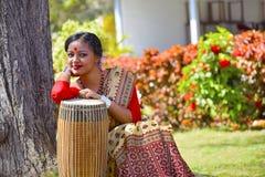 Assamese girl In traditional attire posing with A Dhol , Pune, Maharashtra. Assamese girl In traditional attire posing with A Dhol or Drum, Pune, Maharashtra Royalty Free Stock Photos