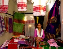Assamese women on her cloth fabric stall-India. Assamese women on her cloth fabric stall at Tribal Art and Craft Fair-India royalty free stock photos