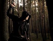 Assassin dans la forêt profonde Images stock