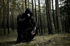 Assassin in the deep forest. Assassin with two swords in the deep forest Stock Photos