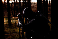 Assassin in the deep forest. Assassin with two swords in the deep forest Stock Photography