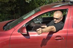 Assassin shooting from a moving car Royalty Free Stock Photography