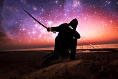 Assassin at starry night Stock Photos
