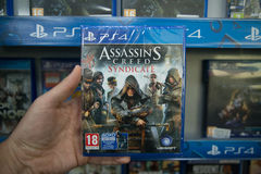 Assassins creed Syndicate. Bratislava, Slovakia, circa april 2017: Man holding Assassins creed Syndicatevideogame on Sony Playstation 4 console in store Stock Photo