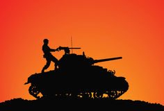 Assault. Silhouette of a soldier on the tank Royalty Free Stock Photography